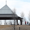 Visitors at Mercy Park enjoy a walk near the pavillion on Tuesday.<br /> Globe | Laurie Sisk
