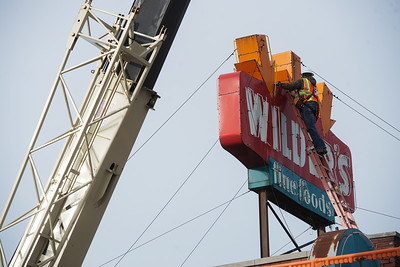 A worker prepares the Wilder's Restaurant sign for removal on Friday in Joplin. Globe | Roger Nomer