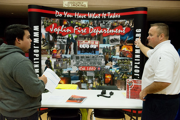 Joplin Fire Department Assistant Chief of Training Scott Cranford, right, talks with Dylan Messer, Joplin, about career opportunities with the department on Tuesday during Job Fest 2018. The annual event drew over 50 employers to Joplin Memorial Hall to connect with potential workers.