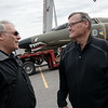 Pete Norwood, left, and Jim Finley talk at Ferra Aerospace on Tuesday as a F-4 is assembled. Norwood is a pilot who has flown F-4s before, and Finley has flown the F-4 that will be on display at Ferra.<br /> Globe | Roger Nomer