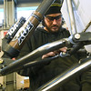 PSu Baja senior Michael Holland works on the front suspension he designed for the club's buggy on Wednesday night at PSU. Members wil spend more than 2,500 hours getting their vehicle ready for competition.<br /> Globe | Laurie Sisk