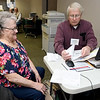 Robert Medley assists Loretta Finney with her 2017 taxes on Thursday at Great Plains Credit Union. Medley has been a VITA volunteer for 13 years.<br /> Globe | Laurie Sisk