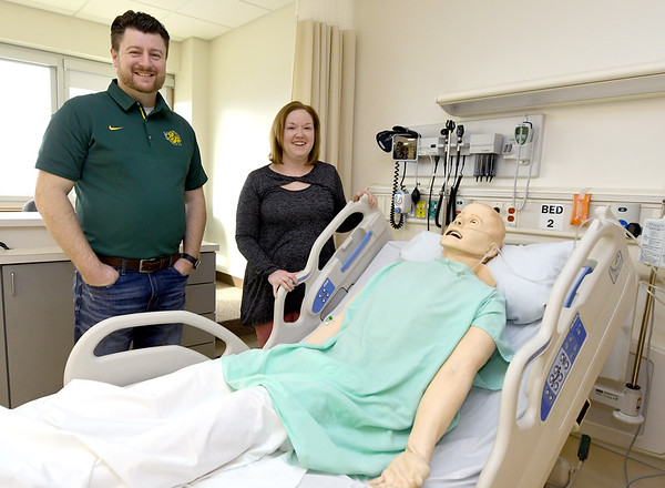 From the left: Caleb Lewis and Sherry Whiteman stand near a resuscitation mannequin on Friday at Missouri Southern's Respiratory Therapy department. The duo has published a textbook for use by other institutions on uses for simulation mannequins.<br /> Globe | Laurie Sisk
