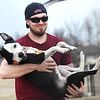 "John Malicoat enjoys springlike temperatures with his female pit mix ""Rukia"" on Thursday at the Parr Hill Dog Park. Colder temperatures are expected Friday.<br /> Globe 