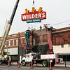 The Wilder's Restaurant sign is removed on Friday in Joplin.<br /> Globe | Roger Nomer