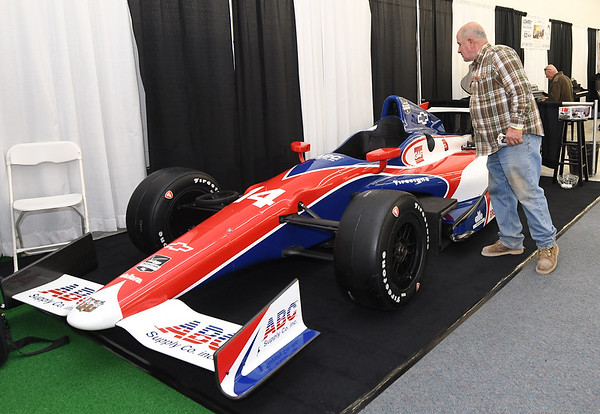 John Allan, of Diamond, checks out an Indy display car on Friday at ABC Supply Co.'s booth at the Home Builders Association of Southwest Missouri Home Show at North Point Shopping Center. The show continues Saturday with about 60 vendors.<br /> Globe | Laurie SIsk