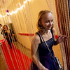Riley Long, 14, Nevada, makes her entrance into the Joy Prom on Saturday at the Barton County Strength Club in Lamar.<br /> Globe | Roger Nomer