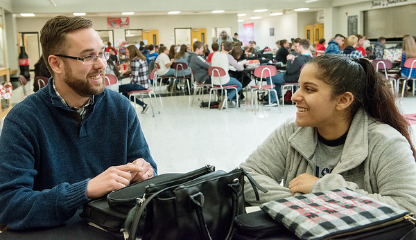 Adam Neldeberg, a counselor at Carl Junction High School, talks with Harmouni Cundiff, senior, over lunch at the school on Wednesday.<br /> Globe | Roger Nomer