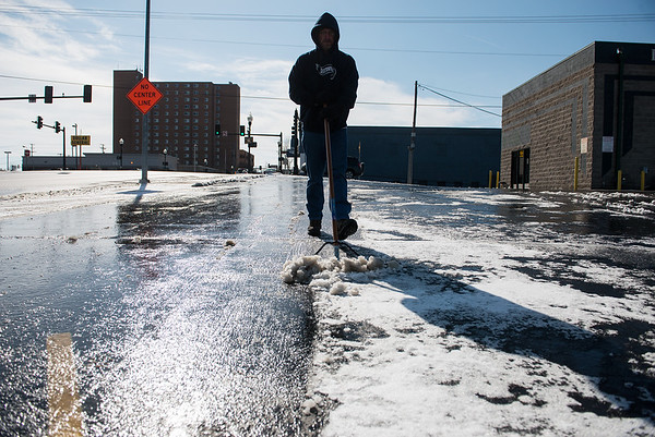 Shannon Smith, manager, clears the lot at Downtown Lube on Monday.<br /> Globe | Roger Nomer