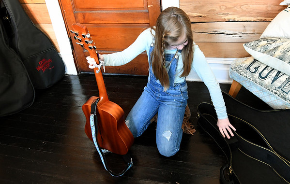 "Ten-year-old Emme Rogers prepares for her lesson on Tuesday at Maple Leaf Music Company in Carthage. Rogers wrote her own single, ""Stand Up,"" after she noticed kids at school being bullied.<br /> Globe 