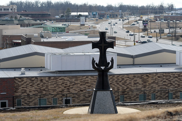 A cross at Mercy Park overlooks construction on the new Joplin Early Childhood Center on Wednesday.<br /> Globe | Laurie Sisk