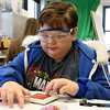 Ten-year-old Seth Gentry creates a stained glass valentine during a special workshop on Saturday at the Spiva Center for the Arts.<br /> Globe | Laurie Sisk