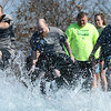 Representatives from Kansas City University take the chilling plunge into 48 degree water during the Special Olympics Polar Plunge on Saturday at the Joplin Elks Lodge.<br /> Globe | Laurie SIsk