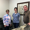 Doug, his daughter Danica and wife Danel pose for a picture at the reception desk of their newly opened dental practice in Neosho. <br /> Globe | Ines Kagubare