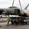 Workers lower a Phantom F-4 body onto its wings on Tuesday at Ferra Aerospace in Grove.<br /> Globe | Roger Nomer