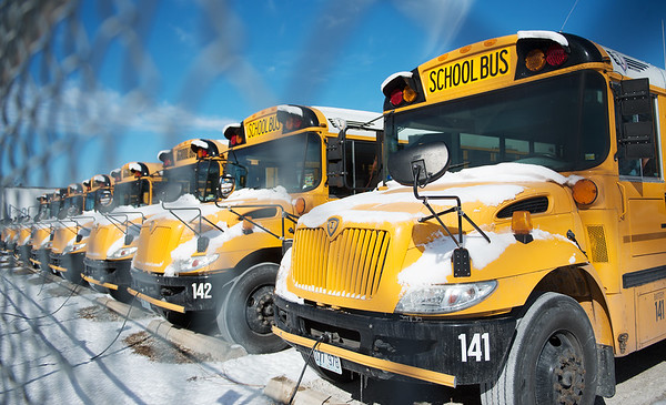 Idle Joplin school busses are covered in snow on Monday.<br /> Globe | Roger Nomer