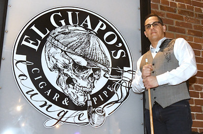 Alex Menejias, owner of El Guapo's Cigar and Pipe Lounge on Joplin street, expresses his concerns over being charged for business licenses three times after he moved his business each time to expand. Globe | Laurie SIsk