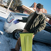 Chris Leiter puts down salt in the parking lot of For All Bible Center on Monday.<br /> Globe | Roger Nomer