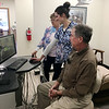 Doug, his daughter Danica and wife Danel look at a computer screen inside their new dental practice on Monday in Neosho.<br /> Globe | Ines Kagubare