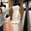 Eight-year-old Lexus Moffett, of Carl Junction, checks out a display of wedding dresses at Lovie's Recycled Weddings during Bridal Bash 2018 on Saturday at the Roxy and Amelie event centers. About 40 vendors were on hand for the evnt.<br /> Globe | Laurie Sisk