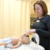Sherry Whiteman works with a pediatric resuscitation mannequin on Friday at Missouri Southern's Respiratory Therapy department. Whiteman has published textbooks in collaboration with four additional faculty members for use by other institutions on uses for simulation mannequins.<br /> Globe | Laurie Sisk