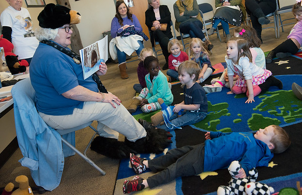 """Vicki Cassady, volunteer at the Wildcat Glades Conservation and Audubon Center, reads a book about bear behavior during the """"Bears, Bears, Bears"""" presentation at the center on Wednesday."""