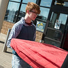 Zachary Davis, a junior at Joplin High School, helps unload props on Thursday at the Home Builders Association Home Show at North Point Shopping Center. Students from Franklin Tech were on location to help set up for the show.<br /> Globe | Roger Nomer