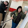 Cory Henningsen, sales representative with ADT Security Services, and Tehya Higginbotham, a Joplin High junior, set up the ADT booth on Thursday at the Home Builders Association Home Show at North Point Shopping Center. Students from Franklin Tech were on location to help set up for the show.<br /> Globe | Roger Nomer