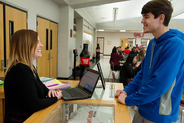 Jen Chase, counselor at Carl Junction High School, talks with Nathanael Barnard, junior, over lunch at the school on Wednesday. Globe | Roger Nomer