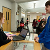 Jen Chase, counselor at Carl Junction High School, talks with Nathanael Barnard, junior, over lunch at the school on Wednesday.<br /> Globe | Roger Nomer