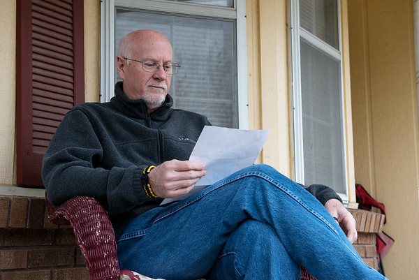 Steve Russell reads a letter of gratitude R.J's donation after his death. The fact that their son was an organ donor and his donations have gone on to help others has comforted the Russells.<br /> Globe | Roger Nomer