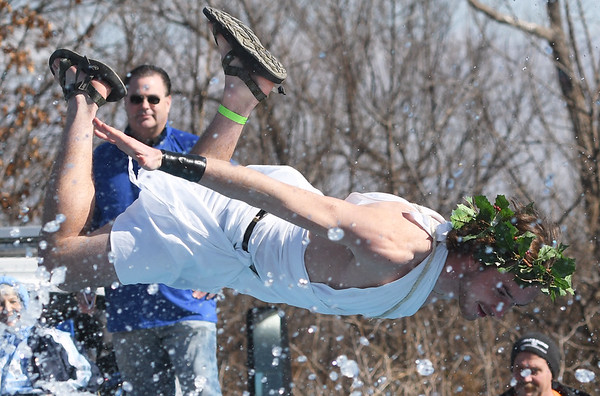 Lucas Berliew, of the Carl Junction High School Student Council, prepares to belly flop into 48 degree water during the Special Olympics Polar Plunge on Saturday at the Joplin Elks Lodge.<br /> Globe   Laurie SIsk
