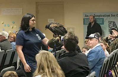 Delia Lister, director of Nature Reach at Pittsburg University presents a Harris hawk to an audience as part of a presentation on raptors on Saturday at the George Washington National Monument. The presentation has been held for four years and has drawn more than 100 people each year.