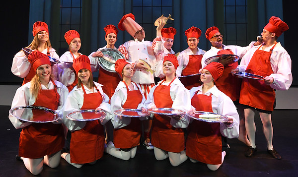 "The Chefs take time out for a photo before their dress rehearsal for the Pitsburg High School production of ""The Little Mermaid"" on Wednesday at Pittsburg's Memorial Auditorium.<br /> Globe 