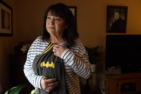 Pat Russell has kept her son's batman jacket and sleeps with it at night for comfort.<br /> Globe | Roger Nomer