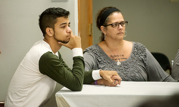 Maquel Harvin and Kayla Beaver, brother and mother of Jalen Vaden, listen to a press conference on Tuesday at the Community Service Center.<br /> Globe | Roger Nomer