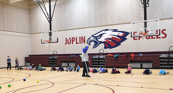 Doug Barto, center, leads gym class on Wednesday inside Columbia Elementary's safe room.<br /> Globe | Laurie SIsk