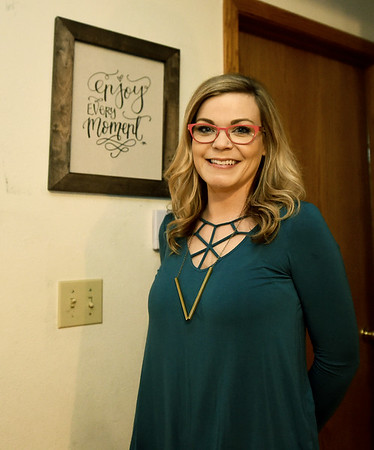 Cancer survivor Lucy Phillips stands beside a plaque in her Carthage home that reminds her that each day is precious.<br /> Globe | Laurie Sisk