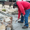Jake Cowen, with Joplin Parks and Rec, cleans off graffiti at Parr Hill Park on Monday.<br /> Globe | Roger Nomer