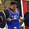 Seventeen-year-old Ramiro Cantu tests his strength and determination against 126.5 pounds in the curl competition on Saturday at the Natural Athlete Strength Association's Missouri Open powerlifting competition on Saturday at McAuley High School.<br /> Globe | Laurie Sisk