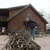 Todd Garner works with a firepit at Little Flat Creek Ranch in Verona on Thursday.<br /> Globe | Roger Nomer