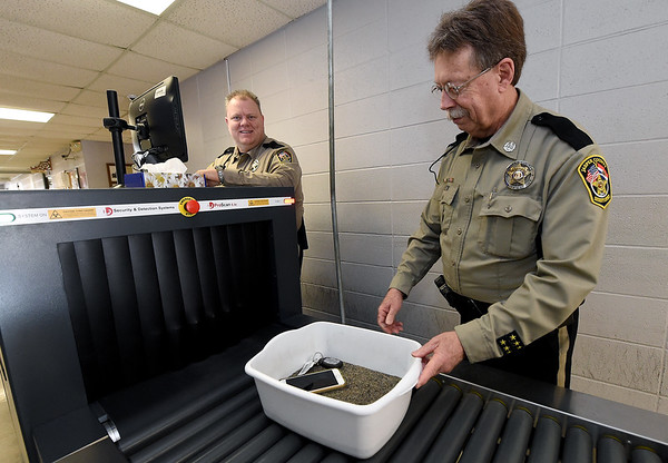 From the left: Jasper County Deputies James Marler and Gary Mason scans items on Friday at the entrance of the Jasper County Courts Building.<br /> Globe | Laurie Sisk