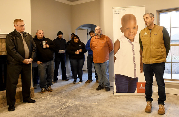 Builder Dan Mitchell, of Schuber Mitchell Homes, addresses a group of sponsors, St. Jude families and builders on Tuesday morning at the new St. Jude's Dream Home. The $275,000 home will be raffled off on May 22. Other prizes include a $10,000 VISA gift card, a $10,000 home accessories package and a Husqvarna automower.<br /> Globe   Laurie Sisk