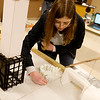 Emily Tappana, a Webb City High senior, helps set up her team's Rube Goldberg machine during Engineering Day at Crowder College on Wednesday.<br /> Globe | Roger Nomer