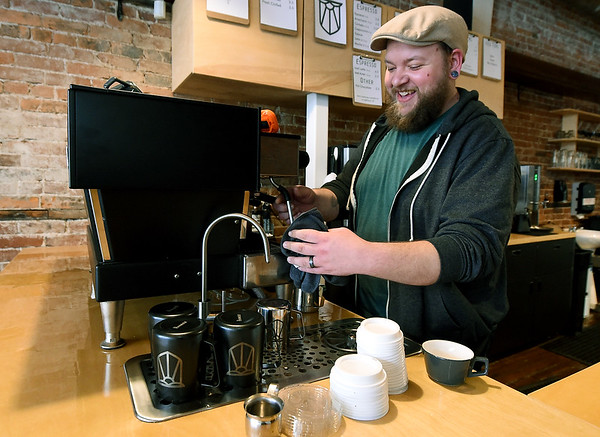 Bearded Lady owner Adam Francis mixes a cappucino in  his shop on Thursday. Francis has grown from roasting his popular coffee to also opening his own shop at 218 S. Main St.<br /> Globe   Laurie Sisk
