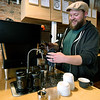 Bearded Lady owner Adam Francis mixes a cappucino in  his shop on Thursday. Francis has grown from roasting his popular coffee to also opening his own shop at 218 S. Main St.<br /> Globe | Laurie Sisk