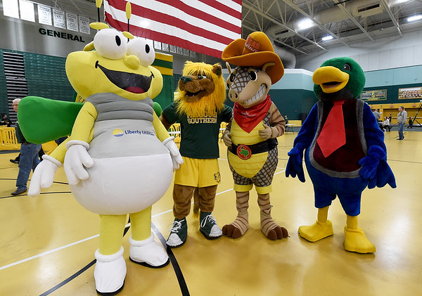 From the left: Liberty Utilities mascot Louie the Lightning Bug, Missouri Southern mascot Roary the Lion, Texas Roadhouse mascot Andy the Armadillo and Homewood Suites mascot Louie the Duck gather to help Roary celebrate his birthday on Thursday night during the MSSU men's and women's basketball games. Roary has served as the MSSU mascot since October 2012.<br /> Globe | Laurie Sisk