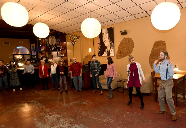 On the right: Ashley and Zachary King teach patrons steps during swing dance lessons at the Joplin Avenue Coffee Company on Thursday night. <br /> Globe | Laurie Sisk