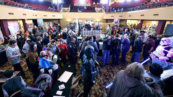 Scores of guests fill the main room at the Neosho Civic Center during the Neosho Arts Council's Artcon on Saturday at the Neosho Civic Center. Proceeds from the event will be used to restore historic murals in downtown Neosho.<br /> Globe | Laurie Sisk