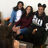 (from left) Meonia White, a Missouri Southern junior from St. Louis, Aliyah McKelvy, a senior from Kansas City, Mo., and Joe Martin, a junior from Miami, Fla., react as they view their caricature drawn by Kansas City artist BeeJay Hawn on Thursday at MSSU.<br /> Globe | Roger Nomer